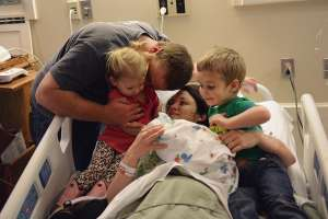 Jacob and Kelsey Wigington share a memorable moment with their children (l-r): Layne, Austin Rose and Charlie.